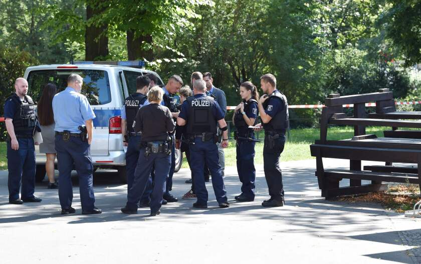 Police in Berlin at the scene of a Georgian man's fatal shooting Aug. 23, 2019. The victim was of Chechen ethnicity and had fought against Russian troops, receiving death threats after he fled to Germany in 2016.