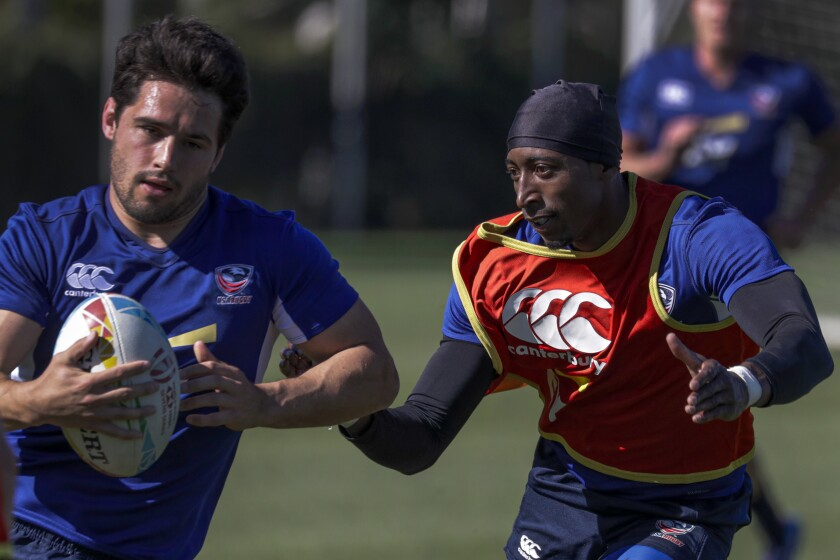 Perry Baker, right, pursues a teammate during a U.S. rugby sevens practice on Feb. 26, 2020, at Dignity Health Sports Park in Carson.
