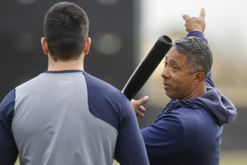 The Padres' assistant hitting and infield coach coach Damion Easley, right, talks to Padres' infielder Hudson Potts during Padres spring training at the Peoria Sports Complex in Peoria, Arizona on Wednesday, Feb. 13, 2019.