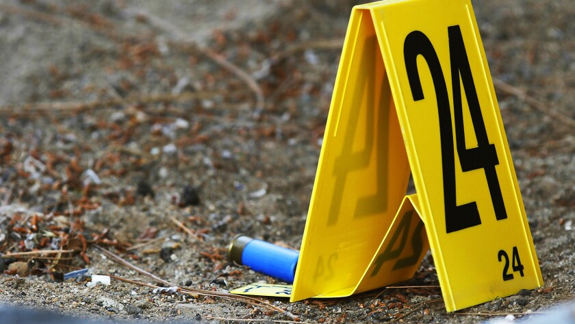Evidence marker shows a shotgun shell casing at the scene of a police involved shooting in the College Area on June 24, 2018