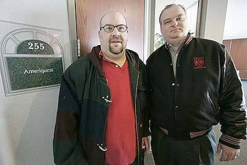 EMPLOYEE GRIPES: Former Ameriquest workers Mark Bomchill, left, and Troy Huston, shown in January outside the Plymouth, Minn., office they used to work at, have criticized the firm's tactics.
