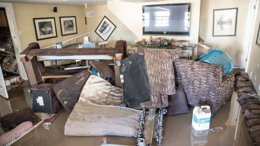 Ruined furniture is piled in a house near Coyote Creek after this week's San Jose flooding.