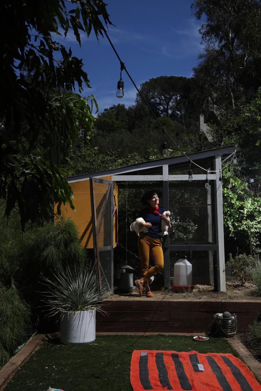 Ellen Bennett relaxes in her Echo Park backyard with her Silkies.