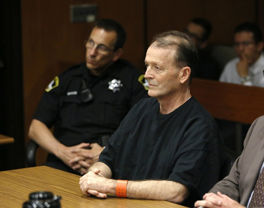Former California fire battalion chief Orville Fleming listens as Sacramento Superior Court Judge Sharon Lueras sentences him to 15 years to life in prison for the second-degree murder of his girlfriend, Friday, July 31, 2015, in Sacramento,Calif. Fleming, 57, was convicted of the 2014 slaying of 26-year-old Sarah June Douglas in their south Sacramento home.(AP Photo/Rich Pedroncelli)