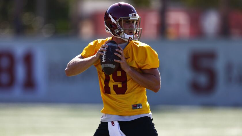 USC quarterback Matt Fink passes during drills at fall camp on the campus of USC.