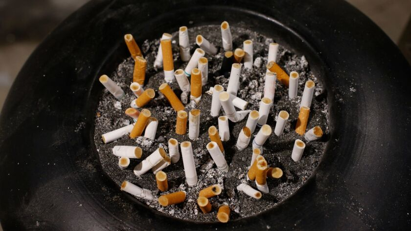 Cigarette butts in an ash tray