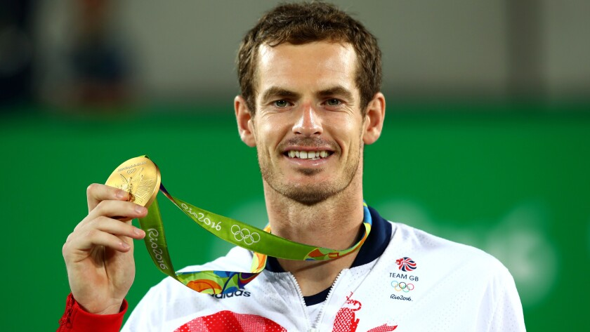 Britain's Andy Murray shows off his gold medal after defeating Juan Martin del Potro on Sunday.