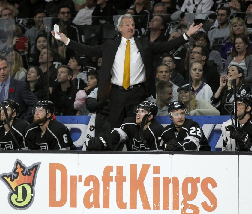 Los Angeles Kings head coach Darryl Sutter extends his arms to talk to a referee after a penalty was called on his team during the second period of an NHL hockey game against the Florida Panthers in Los Angeles, Saturday, Nov. 7, 2015. (AP Photo/Alex Gallardo)