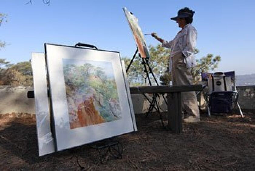 Annette Lotuso Paquet, who has painted scenes at Torrey Pines State Reserve for 30 years, set up her easel near the Visitor Center this week.  (John R. McCutchen / Union-Tribune)