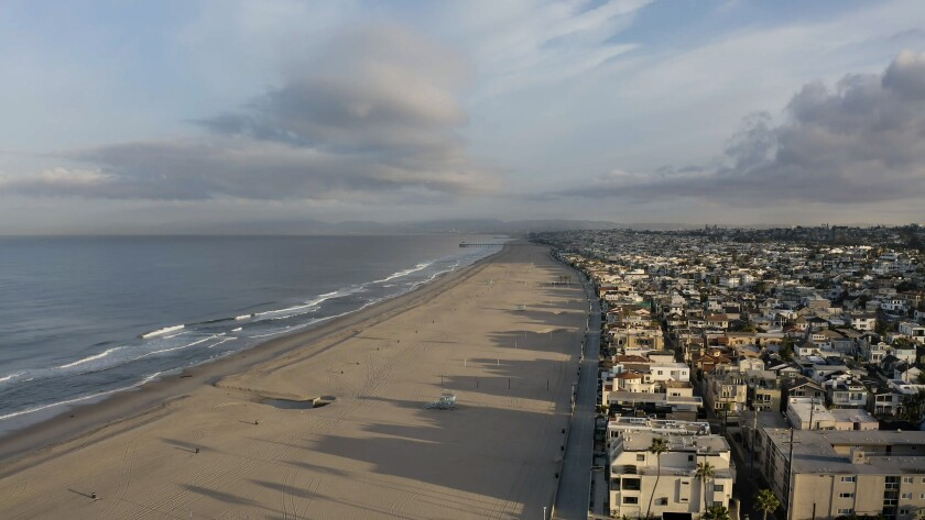 A drone's view of Hermosa Beach, looking north along the Strand, while all beaches in Los Angeles County are closed to slow the spread of the coronavirus.