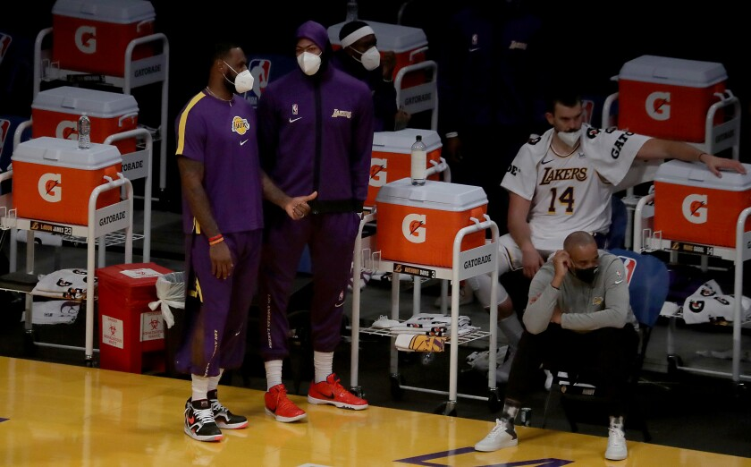Lakers stars LeBron James and Anthony Davis sit out a presaason game against the Clippers on Dec. 13, 2020.