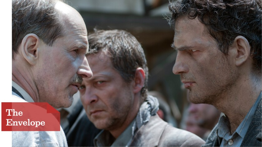 """Saul (Géza Röhrig), right, is an Auschwitz captive forced to help get others to the gas chambers in """"Son of Saul."""""""
