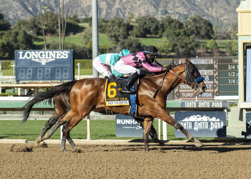 Concert Tour (6) and jockey Joel Rosario edge Freedom Fighter, rear, and Drayden Van Dyke to win the San Vicente Stakes.