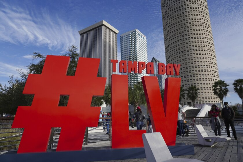 Blue skies and favorable weather greets the thousands of fans attending the festivities at Curtis Hixon Park during the NFL's Super Bowl 55 Experience on Saturday, Jan. 30, 2021 in Tampa. (Luis Santana/Tampa Bay Times via AP)