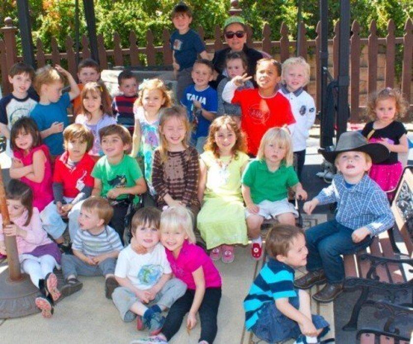 Children enjoy the recent 50th anniversary celebration at Happy Time Nursery.