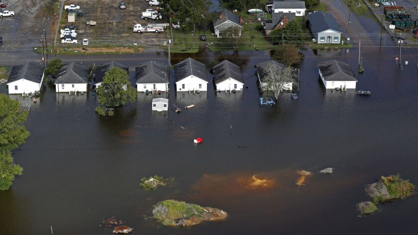 Floodwaters from Hurricane Florence surround homes in Dillon, S.C.