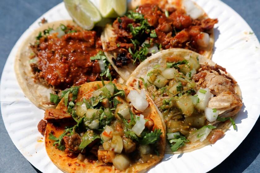 Tacos made with carne asada, al pastor, pollo and carnitas at Taqueria De Anda.