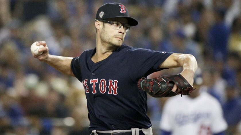 FILE - In this Friday, Oct. 26, 2018 file photo,Boston Red Sox relief pitcher Joe Kelly throws again
