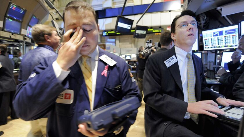 Traders work on the floor of the New York Stock Exchange Thursday, Oct. 23, 2008. (AP Photo/Richard