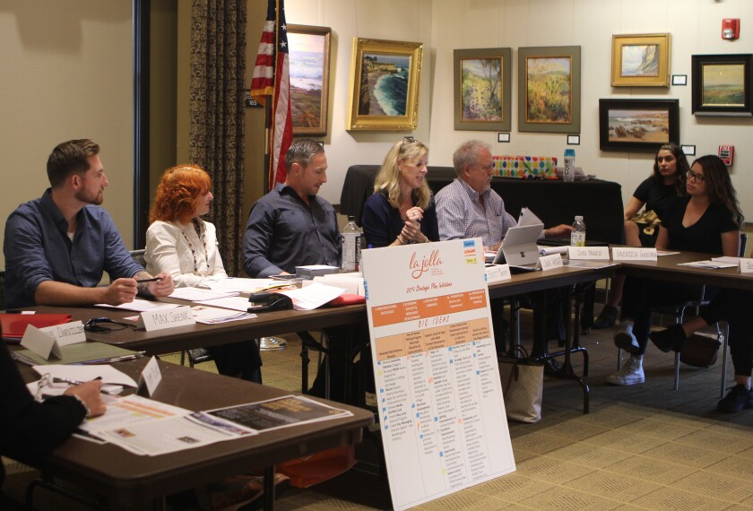 The La Jolla Village Merchants Association (pictured from left: Max Shenk, Jodi Rudick, Brett Murphy, Julie Wright, Don Parks and Gabriela Guevara) announces its newly elected board members on Oct. 9 at the La Jolla Riford Library.