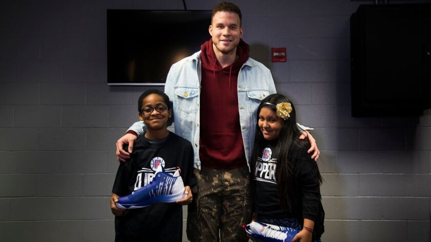 LOS ANGELES, CA - JANUARY 13, 2018: LA Clippers forward Blake Griffin spends moment with Nasir Lucas