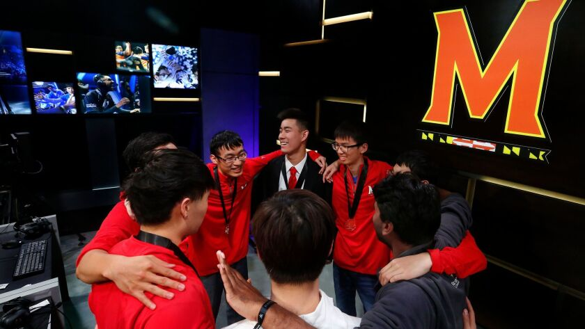 "Members of the ""League of Legends"" team from the University of Maryland huddle after their sweeping victory over the University of Illinois in the Big Ten Network ""League of Legends"" championship at the Battle Theater in Los Angeles on March 27."