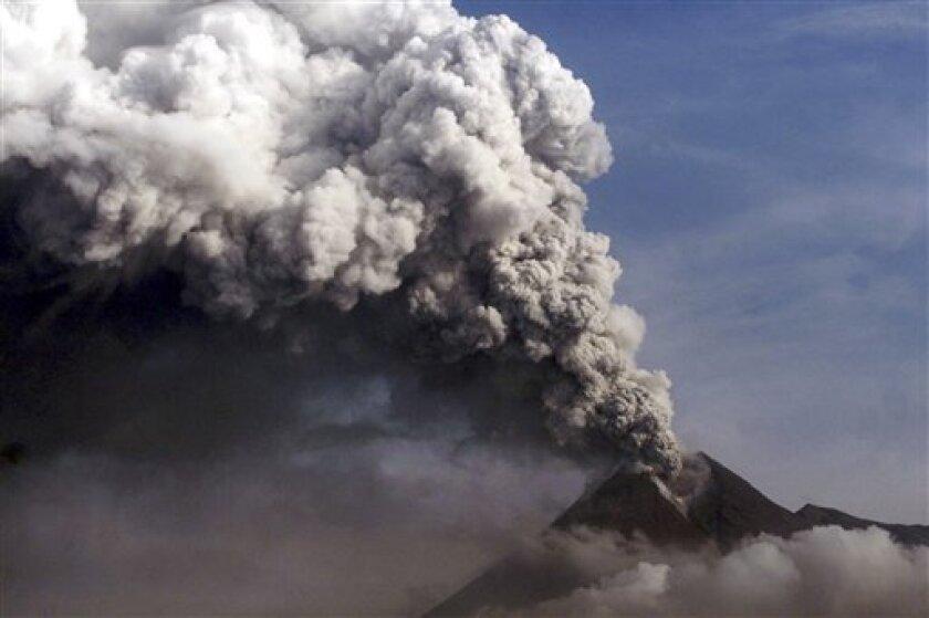 Mount Merapi spews volcanic material as seen from Wukirsari, Indonesia, Monday, Nov. 8, 2010. (AP Photo)