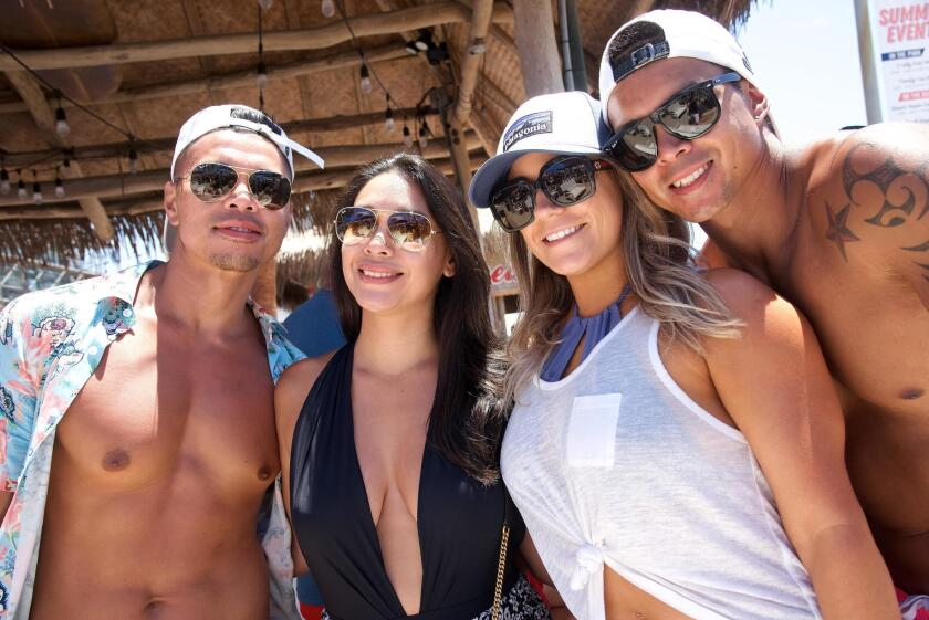 Brian White, Monique Pena, Chelsea Alexander and Neil White enjoy the summer weather at the Beach House in Belmont Park, Mission Beach/San Diego.