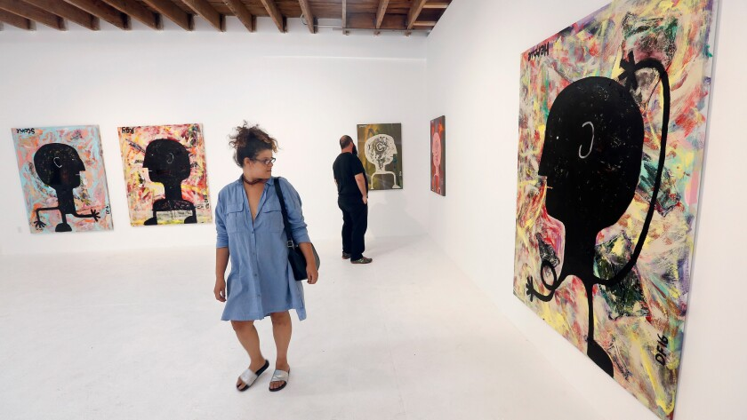 Gallery goers attend an exhibition at Chimento Contemporary in August.
