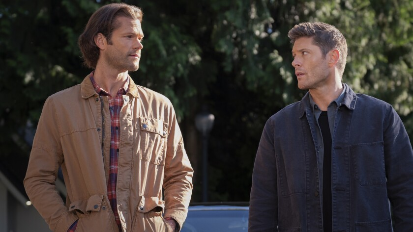 """Jared Padalecki and Jensen Ackles look at each other in """"Supernatural"""" on The CW."""
