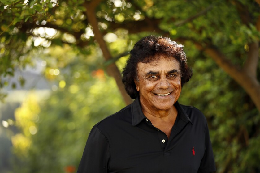 Legendary singer Johnny Mathis at his Hollywood Hills home in 2015. Mathis will perform Sunday at Segerstrom Center for the Arts during his 60th anniversary Christmas Concert Tour.