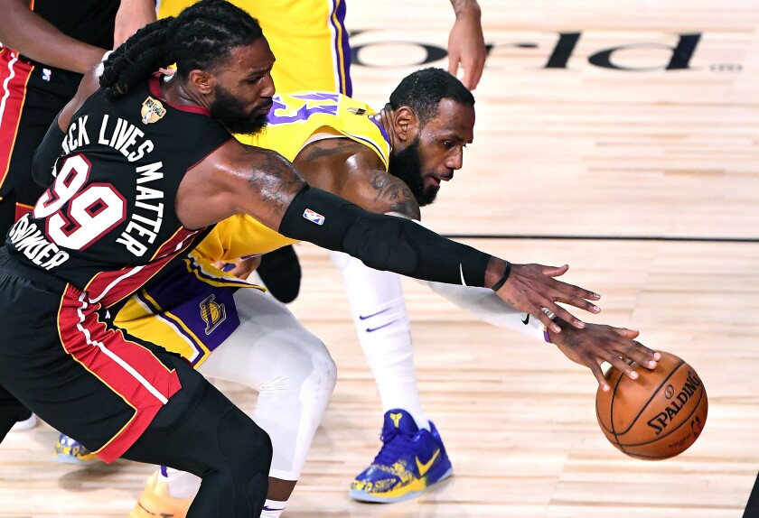 Lakers LeBron James and Miami Heat's Jae Crowder battle for a loose ball.