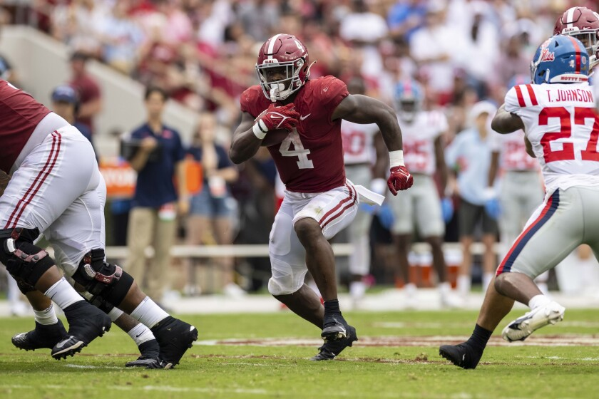 Alabama running back Brian Robinson Jr. (4) runs through an open hole against Mississippi during the second half of an NCAA college football game, Saturday, Oct. 2, 2021, in Tuscaloosa, Ala. (AP Photo/Vasha Hunt)