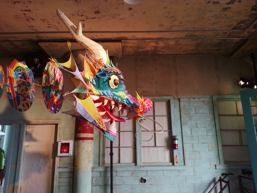 """In an unprecedented exhibition, Ai Weiwei installations devoted to freedom of expression occupy San Francisco's old Alcatraz Federal Penitentiary. """"With Wind,"""" which greets visitors to an industrial building where prisoners used to work, takes the form of a traditional Chinese dragon kite."""