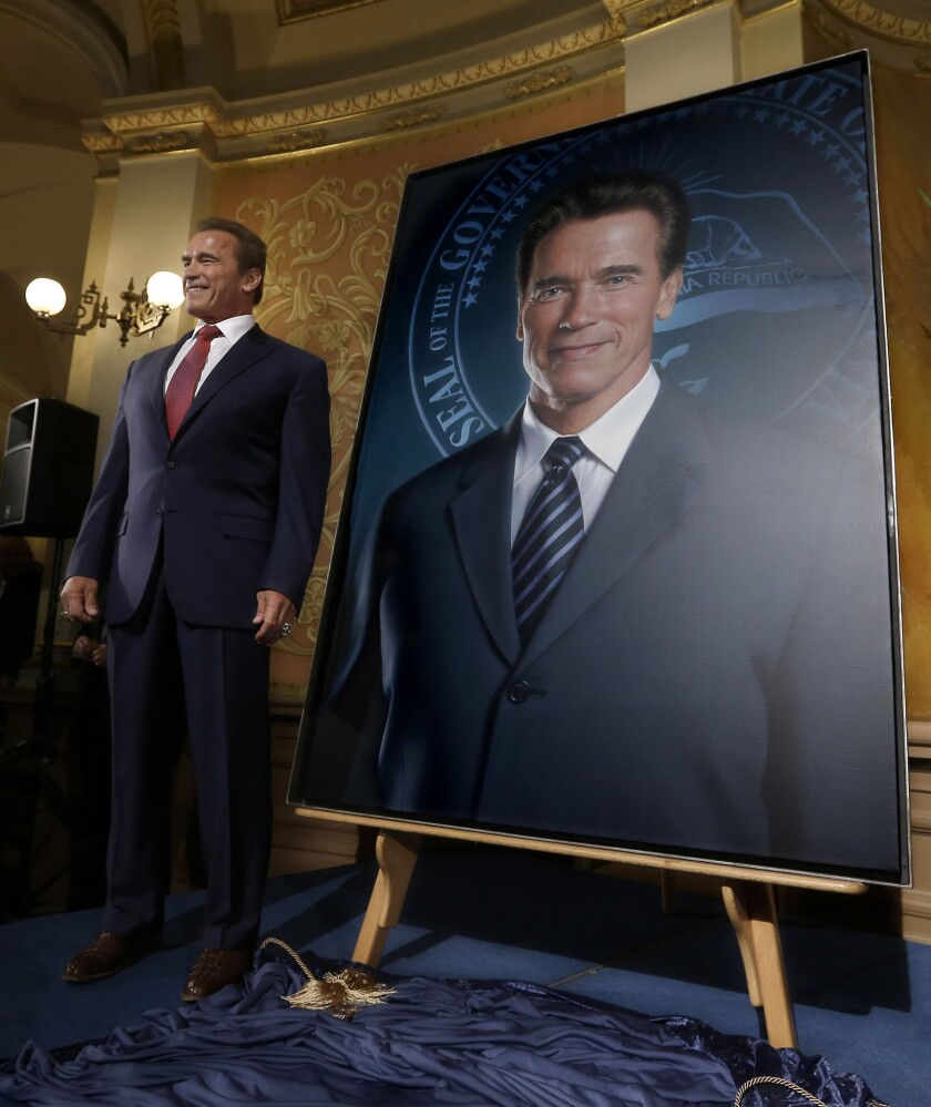 Former California Gov. Arnold Schwarzenegger's official portrait has been unveiled at the Capitol -- minus his ex-wife's face.