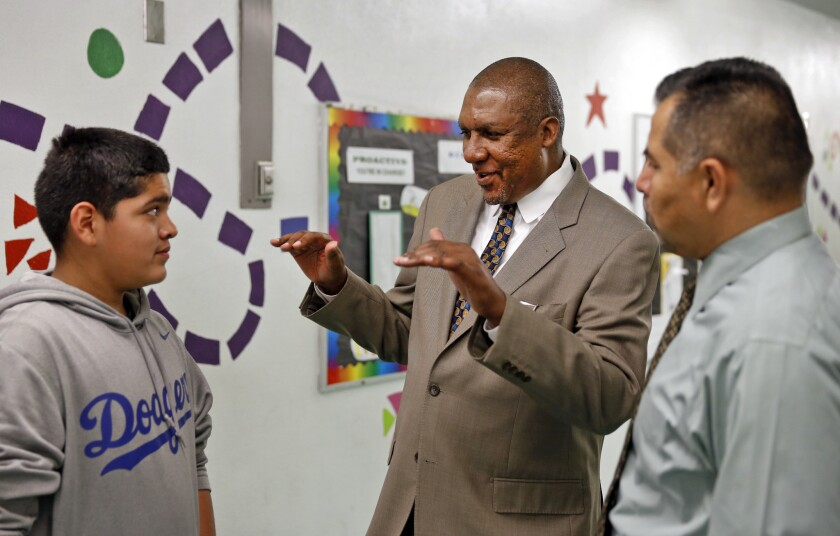 L.A. Unified School District Arts Education Executive Director Rory Pullens, center, visits Normandie Elementary School.
