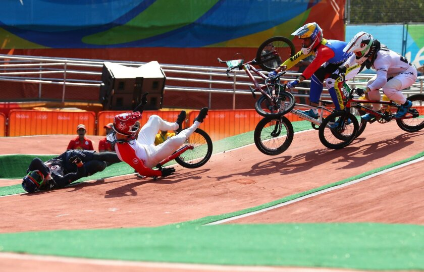 Aug 18, 2016; Rio de Janeiro, Brazil;  Liam Phillips (GBR) and David Graf (SUI) crash during the individual BMX cycling quarterfinal heats in the Rio 2016 Summer Olympic Games at Olympic BMX Centre. Mandatory Credit: Guy Rhodes-USA TODAY Sports ** Usable by SD ONLY **