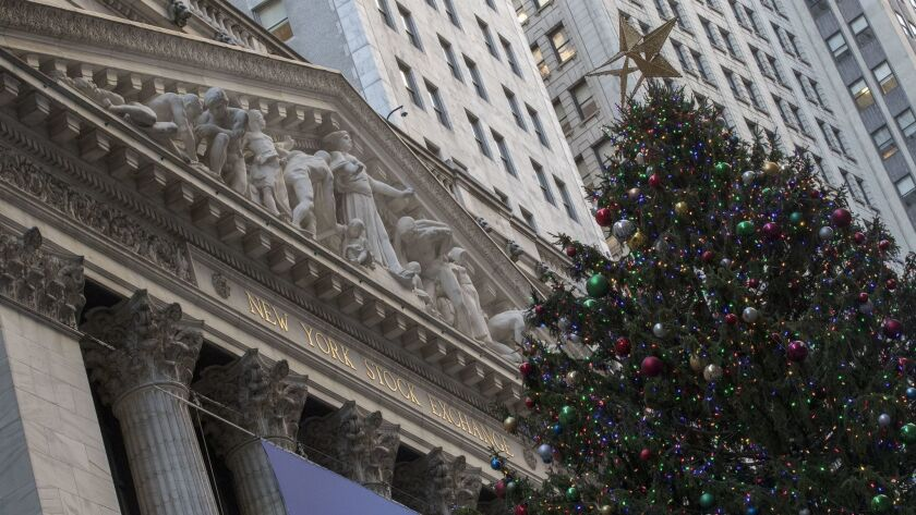 A Christmas tree stands in front of the New York Stock Exchange.