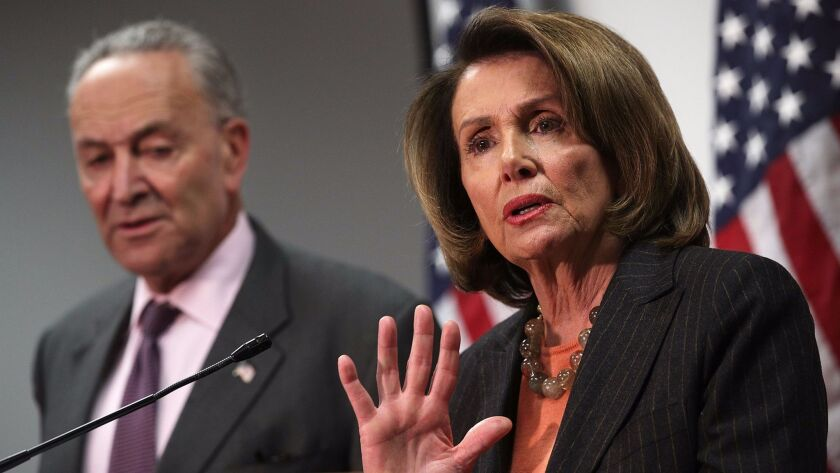 Sen. Charles E. Schumer (D-N.Y.) and Rep. Nancy Pelosi (D-San Francisco) speak at a news conference on the Republican tax proposals in Washington on Nov. 13.