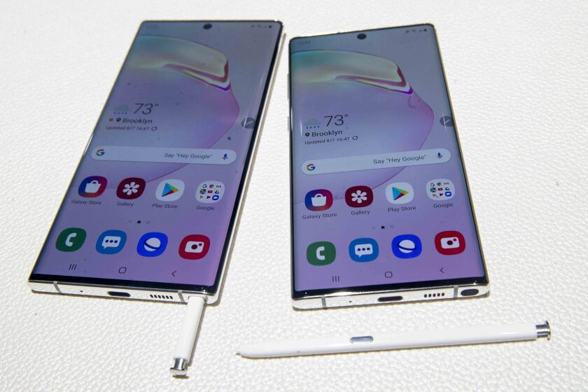This file photo from August shows the Samsung Galaxy Note 10, right, and the Galaxy Note 10 Plus on display during a launch event in New York. The Galaxy Note 10+5G is compatible with AT&T 5G network, which is launching in coming weeks in San Diego.