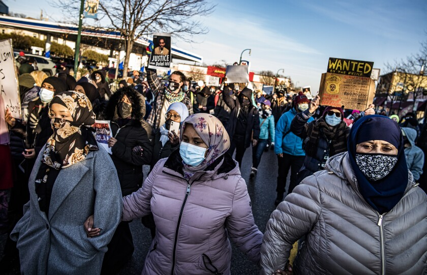 Protesters rally against police brutality Sunday at Minneapolis gas station, where police shot a man.