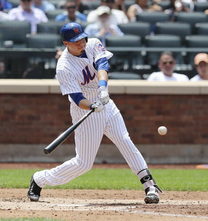 New York Mets' Wilmer Flores hits his second home run during the fourth inning of the baseball game against the Miami Marlins at Citi Field, Wednesday, July 6, 2016 in New York. (AP Photo/Seth Wenig)