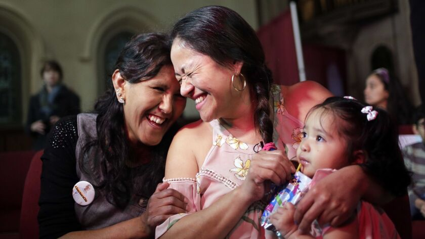Undocumented immigrant Aura Hernandez, center, is being provided sanctuary by the Fourth Universalist Society church in New York.