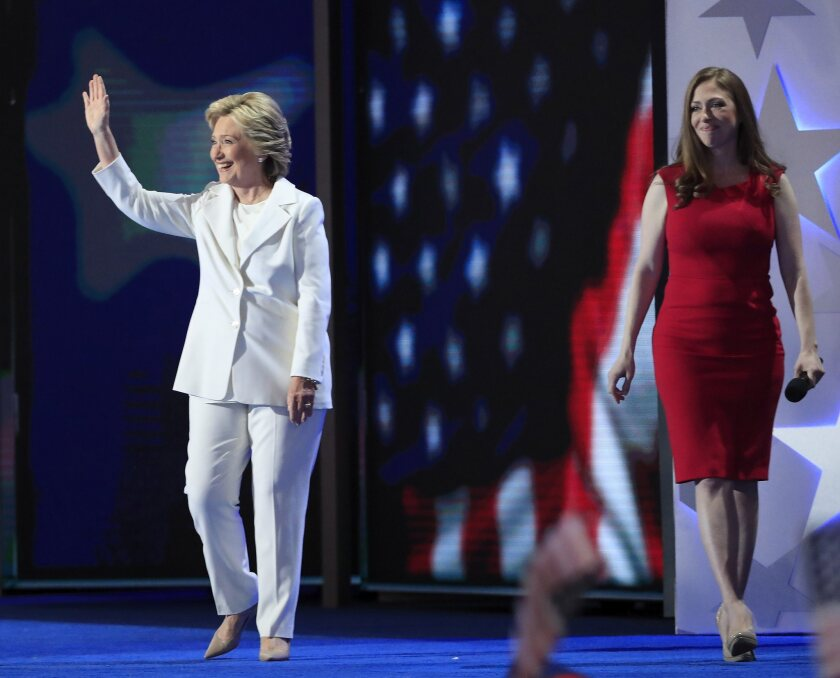 Democratic presidential nominee Hillary Clinton, who appears with daughter Chelsea Clinton, arrives to speak onstage during the final day of the Democratic National Convention at the Wells Fargo Center in Philadelphia.