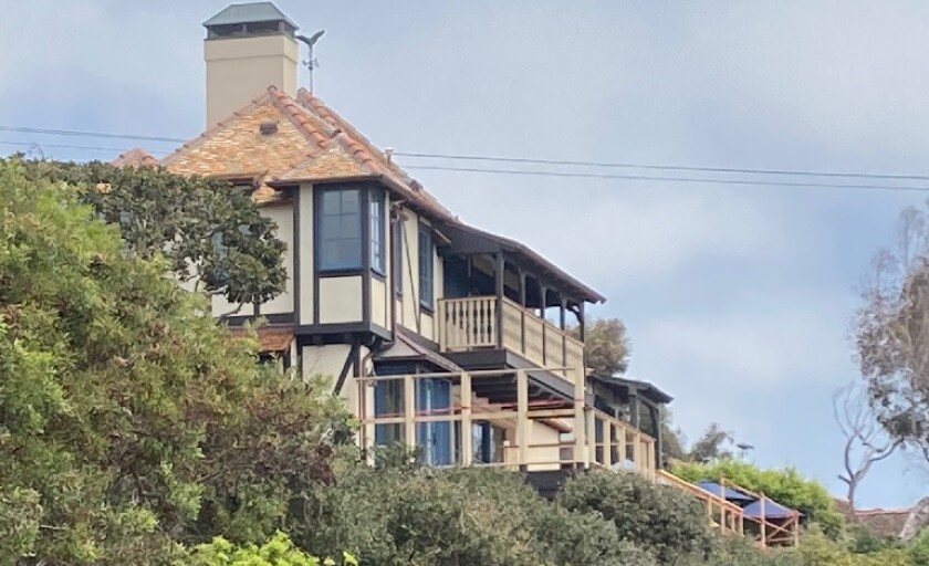 City planners have recommended denial of variance and a permit to enlarge the deck of this house at Saint Malo Beach.