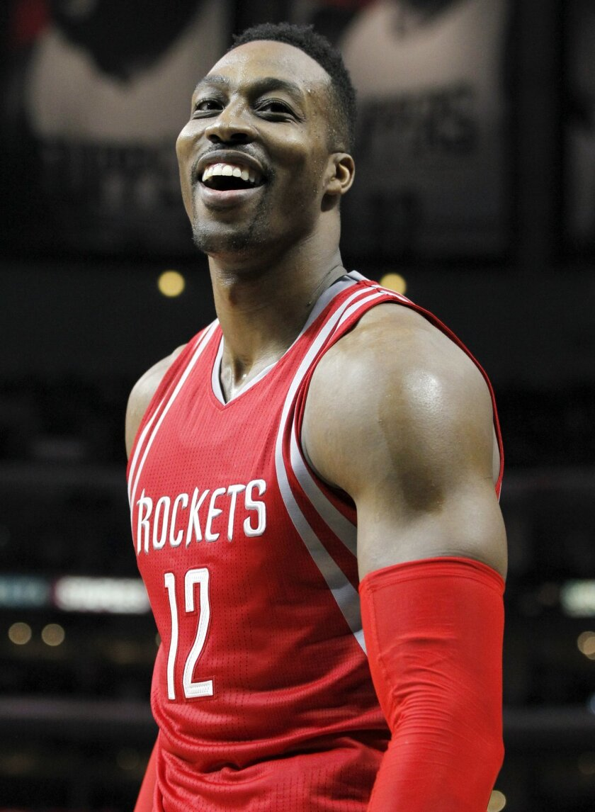 FILE - In this Jan. 18, 2016, file photo, Houston Rockets center Dwight Howard smiles during the second half of an NBA basketball game against the Los Angeles Clippers in Los Angeles.  Rockets general manager Daryl Morey has always been one of the most aggressive dealmakers in the league, and with