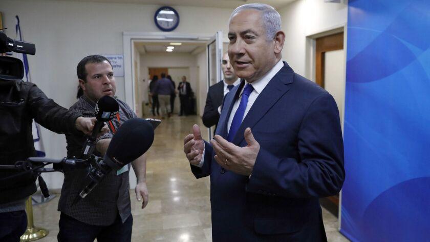 Israeli Prime Minister Benjamin Netanyahu speaks to journalists as he arrives for the weekly cabinet meeting at his office in Jerusalem, Sunday, Feb. 24, 2019. (Abir Sultan/Pool via AP)