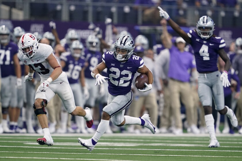 Kansas State running back Deuce Vaughn (22) is cheered on by wide receiver Malik Knowles (4) as Vaughn sprints past Stanford cornerback Ethan Bonner (13) on his way to the end zone for a touchdown in the first half of an NCAA college football game in Arlington, Texas, Saturday, Sept. 4, 2021. (AP Photo/Tony Gutierrez)