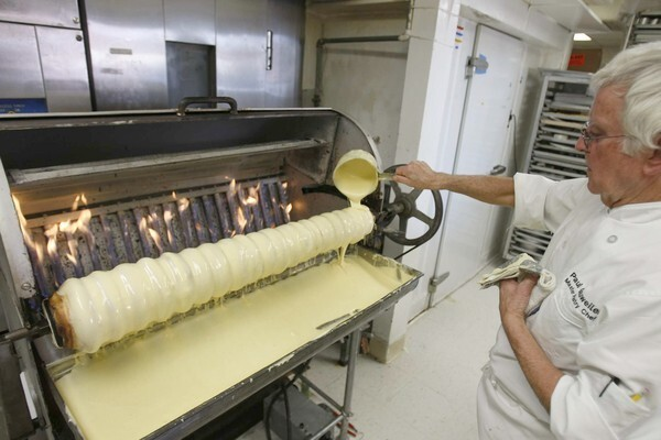 Making baumkuchen -- a German specialty cake -- is both an art and science. Here, Paul Gauweiler pours batter into a baumkuchen machine at the Cake Box in Huntington Beach. The machine is one of only three existing baumkuchen ovens in the U.S. What follows is a behind-the-scenes look at Gauweiler and his wife, Irene, at work.