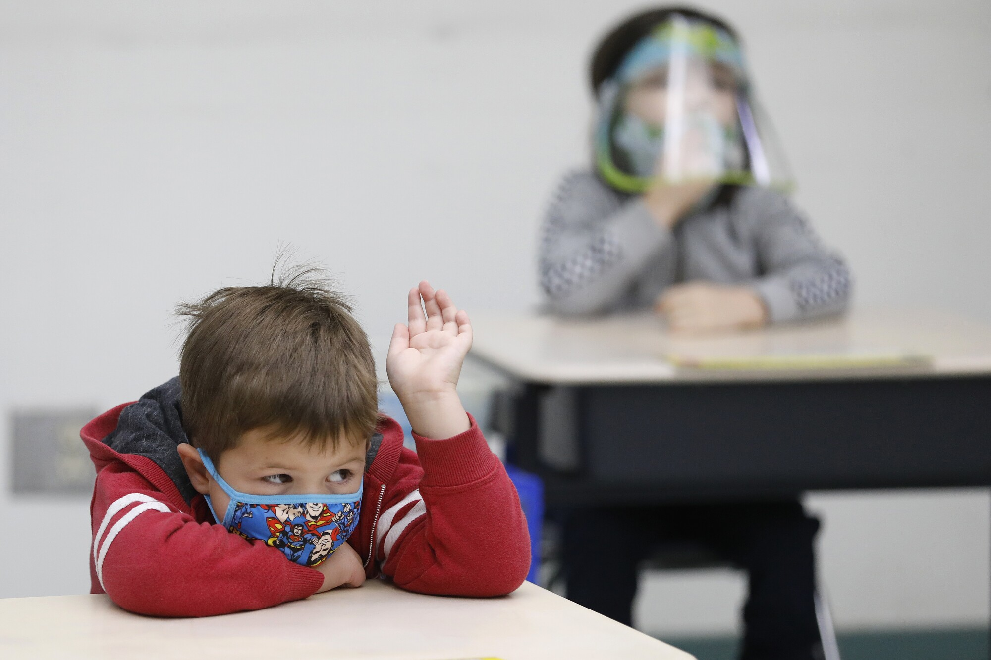 Nathan Marzouk raises his hand during class with kindergarten teacher Ursula Dysthe at Lupin Hill Elementary School.
